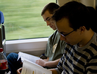 reading bookkeeping course on train